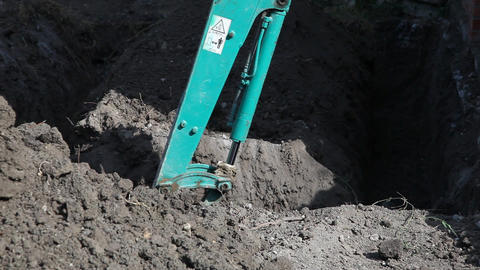 Excavator digging a trench Stock Video Footage