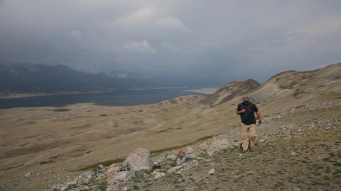 Mountain Hiking in Mongolian Altai at Khoton Nuur lake Footage
