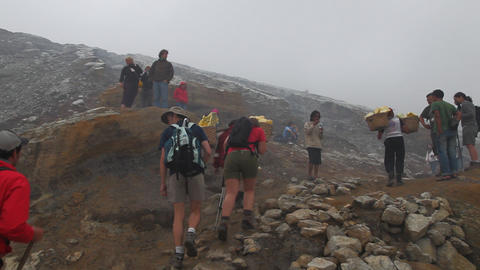 Tourists at crater Ijen Volcano Stock Video Footage