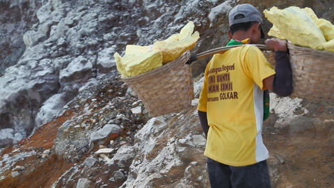 Worker at crater Ijen Volcano Stock Video Footage
