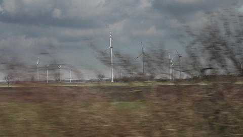 Country landscape view with windmills from moving train, Austria Footage