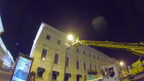 The lamplighter repairs street lamp Stock Video Footage