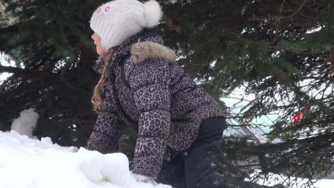 Girl under the tree in winter forest Footage