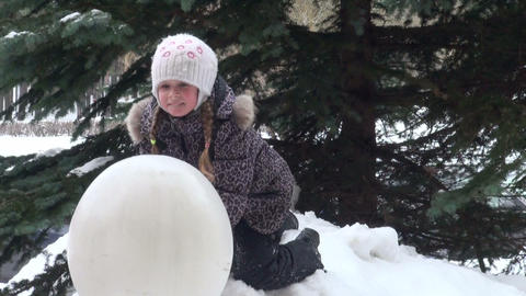 Girl under the tree in winter forest Stock Video Footage
