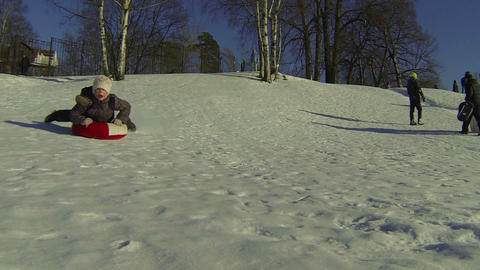 Children, slide, down, icy, hill Footage
