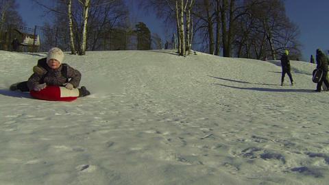 Children, slide, down, icy, hill Stock Video Footage