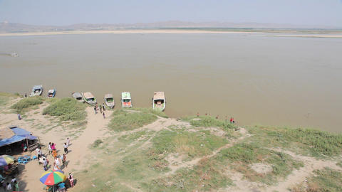 People near Buphaya Pagoda on Irrawaddy River Stock Video Footage