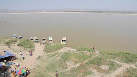 People near Buphaya Pagoda on Irrawaddy River Footage