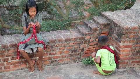 Young souvenir sellers in temple in Bagan Footage