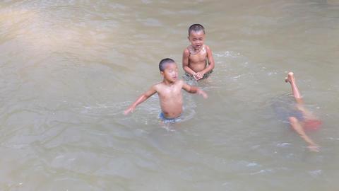 Swimming children Indein village, Myanmar Footage