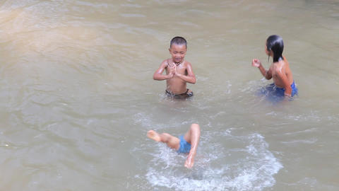 Swimming children Indein village, Myanmar Stock Video Footage