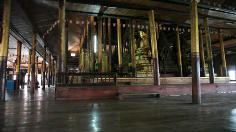 Visitors inside Nga Phe Kyaung Monastery Stock Video Footage