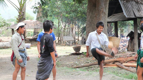 Young adult play ball in Samkar village Footage