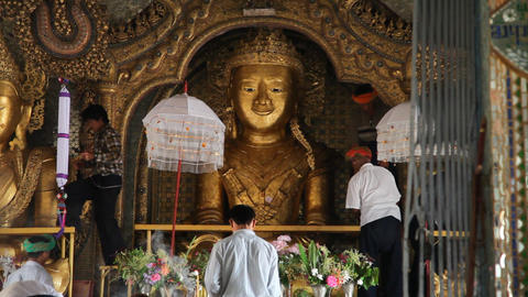 Visitors inside Taung Tho Pagoda Stock Video Footage