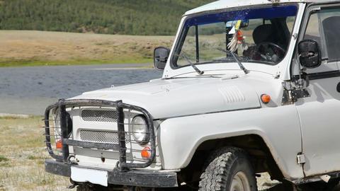 Jeep at coastline of Dayan Nuur lake Stock Video Footage