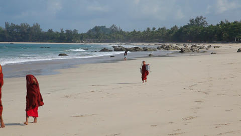 Monks on white sand beach Footage