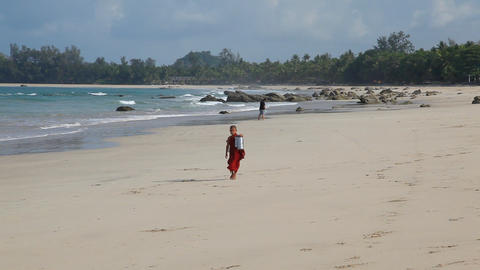Monks on white sand beach Stock Video Footage