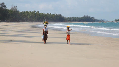 Sellers on white sand beach Stock Video Footage
