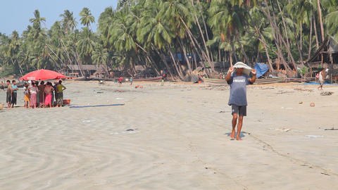 Fishing village sand beach Stock Video Footage