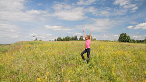 Girl in the summer field Stock Video Footage