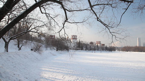 People walking at Novodevichy Convent pond Footage