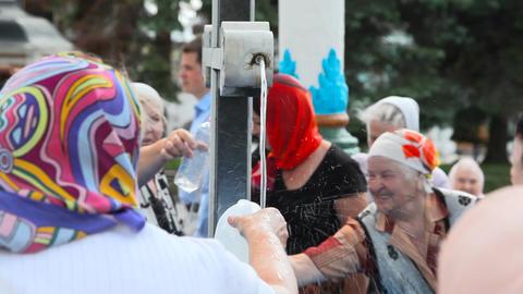 Pilgrims in Holy Trinity Saint Sergius Lavra Stock Video Footage