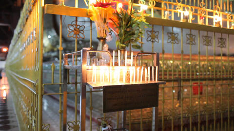 Candles inside Chauk Htatt Ghyee pagoda in Yangon Footage