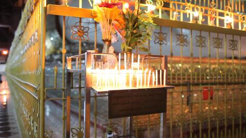 Candles inside Chauk Htatt Ghyee pagoda in Yangon Stock Video Footage