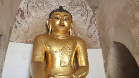 Gold Buddha inside pagoda in Bagan Stock Video Footage