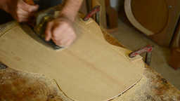 Giving Wood Planer To Flamenco Guitar stock footage