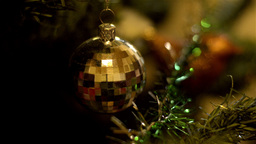 Golden Bauble Hanging On A Christmas Tree stock footage
