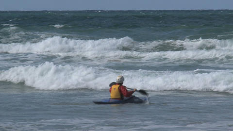 Group people Kayaking against the waves Stock Video Footage