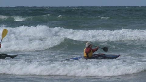 Group people Kayaking against the waves Footage