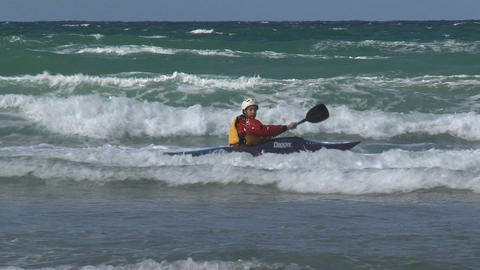 Kayaking against the high waves Footage