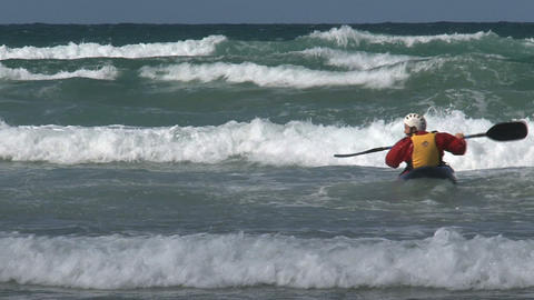 Kayaking against the high waves Stock Video Footage