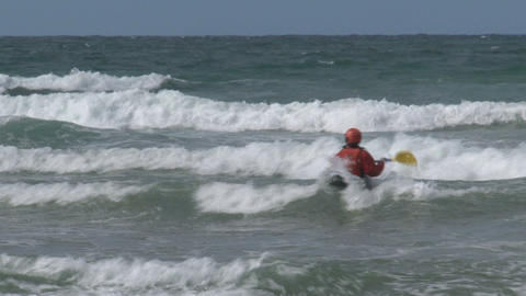 Moving backwards when Kayaking against the waves Footage