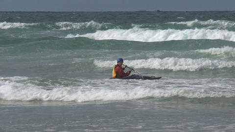 Kayaking against the waves Stock Video Footage
