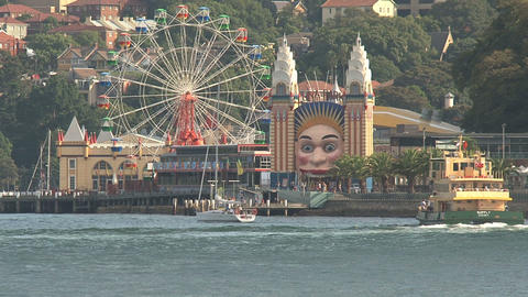 Ferry arriving at amusement park Stock Video Footage