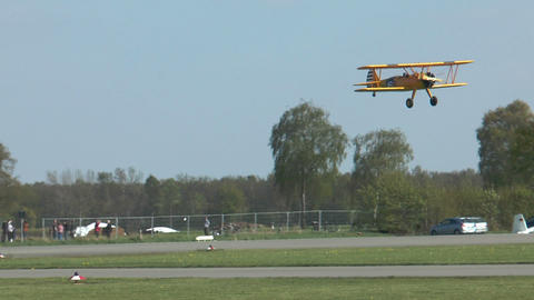 Historic military biplane boeing stearman touch down Stock Video Footage
