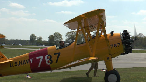 Historic military biplane boeing stearman turning on grass Stock Video Footage