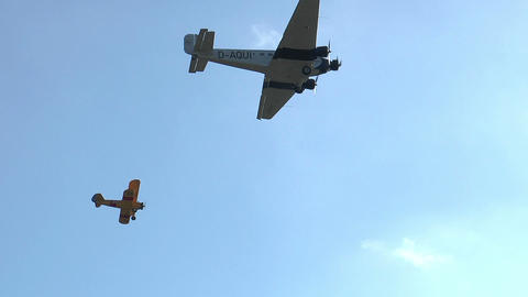 Historic military ju52 and boeing stearman formation flyover Stock Video Footage