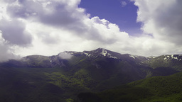 Time Lapse Of Cloudy Sky Over Mountain Peaks stock footage