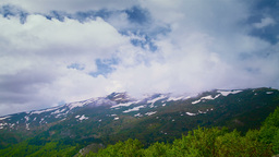 Time lapse of cloudy sky over mountain peaks Stock Video Footage