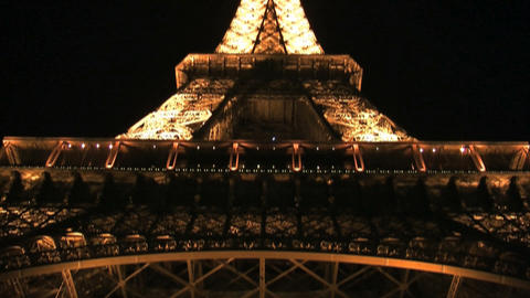 Tilt from the Eiffel tower at night Stock Video Footage