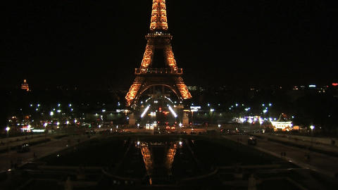 Eiffel tower at night tilt Stock Video Footage