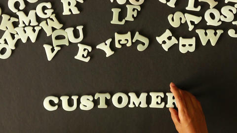 A person spelling Customers Stock Video Footage