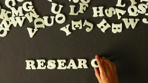 A person spelling Research Animation