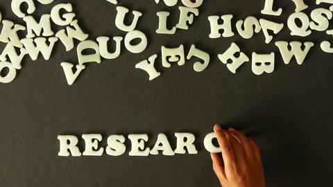 A person spelling Research Stock Video Footage