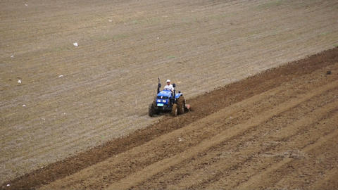 Tractor Plowing A Spring Field 05 stock footage