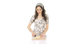 Young brunette chopping lemon Footage